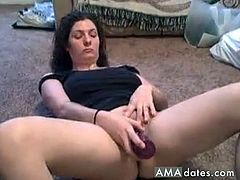 Dark-haired milf is on the floor with her legs spread wide open as she dildo fucks her fat and hairy snatch.