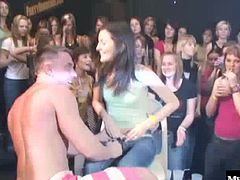 Natural boobed brunette on her knees giving one of the male dancers a deepthroat blowjob, while behind her is another brunette with a tattoo and a very nice round bubble butt, getting fucked hard from behind for a creampie.