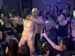 She gets up on stage and strips down to her Birthday suit, showing everyone her big natural tits and her bubble butt that some guy runs up to and buries his face in her butt crack as he performs the motorboat for a cheering crowd.