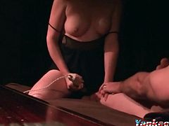 A kinky amateur sex video featuring a guy jerking off while watching his busty wife masturbate with a vibrator.