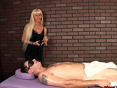 Stressed after so much hard work at office, this guy get to know about the blonde masseuse better at his daily massage treatment. Perverted as always, she wouldnt hesitate to ask for a happy ending from the mature lady. She agrees to give him what he needs but on her terms. She makes the guy blind folded and ties down his cock and balls before starting.