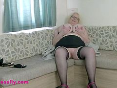 Granny pulls her big tits out of her wooly jumper