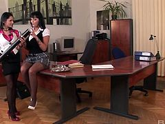 Sex-hungry Jasmine Black brought a double ended dildo for crazy fun in the office