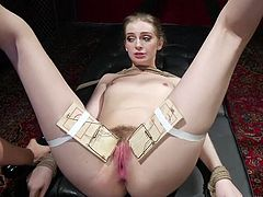 The mean mistress is in total control of this bound slave. Her legs are spread wide so she can do anything she wants to her. She has a big dildo shoved inside of her, and the vibrator makes her cum so hard.
