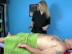 This guy comes in for a massage and the hot blonde starts her job. Accidentally she touches his cock and this gets both into subject. This guy takes the opportunity to ask for a happy ending. That switches the innocent mood of the white babe and she calls in for a mature lady to give him a better treat. Both tie him up on the massage table and next put ropes around his balls and cock making him yell in agony. Next they jerk his cock off for good till he explodes.
