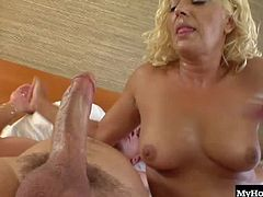 She can take him into the bedroom and give his big fat cock a blowjob, while holding his nut sack. Next, she rides his pole, allowing you to see her real tits and shaved twat, until he pulls it out and jerks off a cumshot all over her hooters.