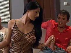 Sofia Cucci jerking off the cock of a group of men