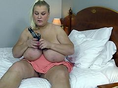 Sammy is a big lady, but pretty and she's ready for action. Note how she treats her vibrator; now imagine that's your cock! Pretty tempting, right? When the night's over and you've spent your energy, you can bed down using those monstrous tits for pillows.