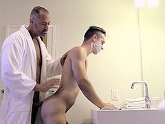 Dads have been teaching their guys how to shave for ages. Very few, however, get hard by doing it. Luckily for this guy, his friend has no trouble giving him a hand and showing him a thing or two in the bathroom. But seeing the young guy in just a towel, he can hardly contain himself, leading him to give him a really important lesson: how to get fucked by his old man!