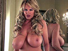 Kelly Madison takes off her amazing outfit for a masturbation