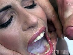 Tattoed and pierced brunette Silvana swallows sperm. She doesn't like hot jizz pouring into her mouth. She tries to smile struggling with disgust in a hot gokkun scene.