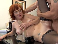 Kinky red haired bitch Audrey Hollander gets her anus rammed and toyed