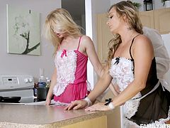Dude with a thick veiny dick fucks two lovely babes in the kitchen