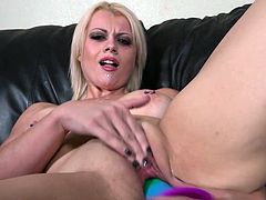 Busty Nadia stuffs her tight pussy with a rainbow dildo