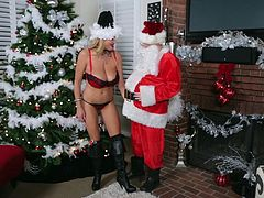 Kelly Madison is a cock craving babe who wants to fuck Santa
