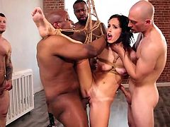 Sexy milf, Alana Cruise, was tied with ropes and suspended in the middle of the room, to give the better access to her wet pussy and tight asshole. Five horny guys want to get a piece of her juicy cunt so, it will be one really hot gang bang... Join!