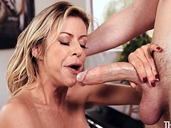 Blonde milf goddess Alexis knows how to get a man off. She wraps her huge melons around her man's cock and gives him a tremendous titjob. She loves to deepthroat him and slobber all over his penis until he is ready to blow his sperm on her.