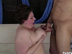 Jolly bbw brunette babe with massive tits and ass gets pounded by a big hard cock in a couch sex. Serving a genuine tit and mouth fuck. Showering her huge breasts with warm sticky cum.
