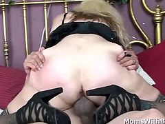 Chubby blonde mature Sundara in sexy black stockings spreading her legs revealing her freshly shaved pussy. Sucking young cock and cowgirl rides with his cock inside her. Ending their sexcapades with a hot creampie.