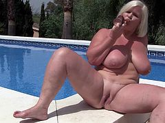 Lacey is big, beautiful and so very horny. She sits by the swimming area completely nude with her legs spread wide. This chubby and busty mature lady loves it when guys watch her masturbate and cum all over the place.