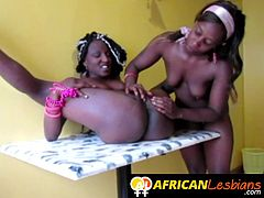 Real ebony lesbian spreads her legs for girlfriend on kitchen table in homemade sex tape.