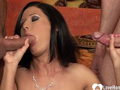 After sucking their hard cocks, this beautiful brunette babe will get rammed hard.