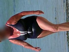 lovely sexy granny in the wet blue swimsuit
