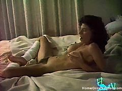 Sexy hairy mature with big natural tits spreads to get licked then lays face down on the bed and gets fucked deep in vintage homemade video