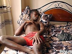 Kicked back on his bed, black African twink Kevin is already hard before he strips off his underwear. A squirt of lube gets his hand greased up for the task and the young man begins stroking his stiff dick in earnest. After edging himself a few times, the horny boy reaches that point of no return and releases his warm cum. He smears that mess around on his belly, as this hot solo scene comes to an end.
