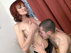 This sexy redhead lays back and lets her horny lover stick his tongue deep into her wet pussy. She is going to cum so hard when she reaches orgasm. He kisses her all over and sucks on her saggy old tits.