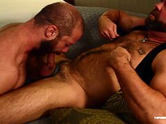 Topher and MuscleBull are back at it again. After a workout and the worshiping of their pumped muscles, the horny men start off with some solo action that ends up right where we like them. MuscleBull plows Tophers hole with a hot barebacking, before shooting a massive cum load.