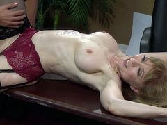 Nina Hartley fucked by stud in the office