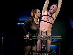 Dozer wants to be the one tied up, and Bella happily makes that happen. She gets him in a bondage device, smacks him, puts clothespins on him, and other things to make him tortured and crazy with lust. Yes, she can make the pain seem like pleasure, and she does it well. Be a good boy, Dozer!