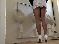 Crossdresser lacy mini dress in public toilet.