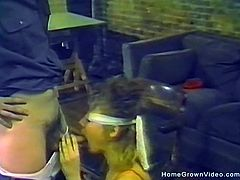 Blindfolded blonde babe with perky tits sucks a hard cock in this vintage homemade video