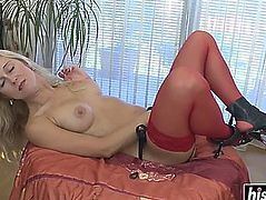 Blond angel plays with a sex tool