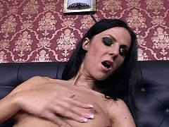 When Brenda Black is horny it's anybody's guess what she'll turn to, to satisfy her need for sex. Watch Brenda play with the camera while sitting on a black couch in this erotic scene