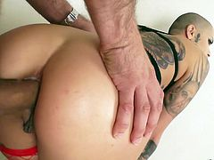 Bald headed tattooed hooker Leigh Raven takes a thick dong in her gaped ass hole
