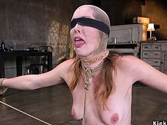 Spreaded blindfolded sub whipped