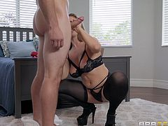 This sexy milf was spying on a hunk and getting so turned on. She slipped open her robe and started touching herself. Soon she was dripping wet. After slipping into some sexy lingerie she sucks on his big cock and makes him cum hard.