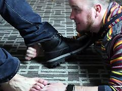 Salt Lake Foot Man, of Xtube fame, provides a full service foot cleaning from boots, to socks and toes. Topher Phoenix cant help but moan as Salt Lake Foot Man literally worships the ground he walks on. Topher leaves a boot print, spits on the man, and talks down to him, making sure Salt Lake Foot Man is not able to pleasure himself until his job is finished.