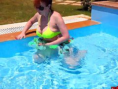 Naughty mature redhead Red XXX was relaxing in the pool when the urge to masturbate came over her. She slide her bikini bottoms off and began fingering her tight little snatch!