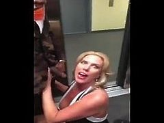 Blonde MILF sucks black cock in an elevator
