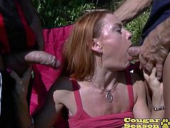CougarSeason - Big tit redhead MILF Janet Mason has an insatiable desire for sex that can only be fulfilled by having all of her holes stuffed! Janet has each of her holes filled with big cocks until they both explode and spray her face with cum!