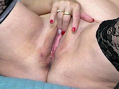 Watch this old mature spread her legs wide and play with her vagina. She slides her fingers deep into her pussy and gets herself off. The dildo goes so deep into her vagina and she is having an intense orgasm.
