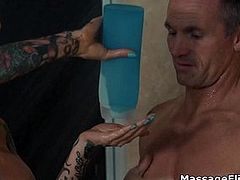 Tattooed oily masseuse rides clients cock