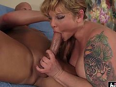 Girl with tattoos rides a dick