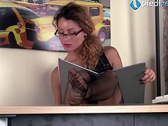 Redhead secretary in stockings shoeplay under the table