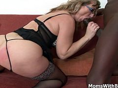 Blonde granny Aja wearing her favorite corset and stockings spreading her thighs for a hardcore interracial fucking. She obviously want to suck the whole cock full but it's just too big for her throat.