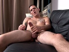 Tattooed army stud solo tugging fat cock